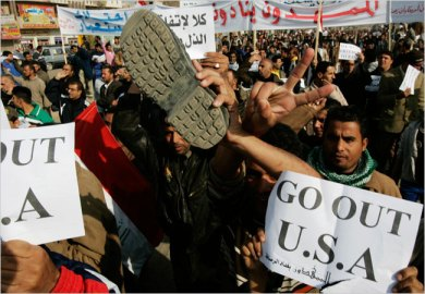 A shoe was raised during a protest against President Bush in the Shiite stronghold of Sadr City in Baghdad on Monday