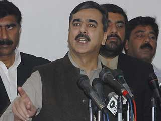Pakistan's Prime Minister Yousuf Raza Gilani addresses reporters in Multan, Pakistan.