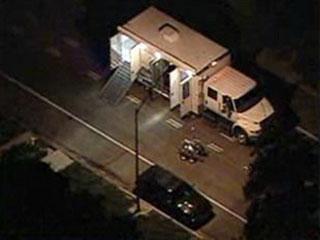 A bomb squad investigates missing 'Santa Shooter' vehicle.