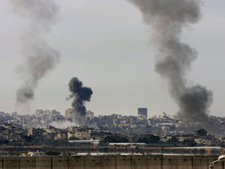 Smoke rises from Israeli missile strikes in the northern Gaza Strip as seen from the Israeli community of Netiv Hasara