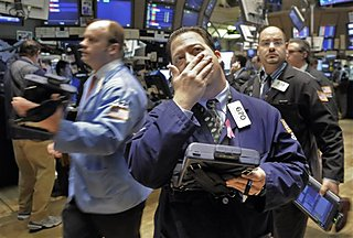 Traders work on the floor of the New York Stock Exchange, Wednesday, Dec. 10, 2008.