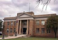 In this Nov. 10, 2008 file photo, the Apache County Court House is seen in St. Johns, Ariz. Prosecutors and a defense lawyer in rural eastern Arizona are trying to figure out what to do with an 8-year-old boy accused of shooting his father and his father's friend in early November.