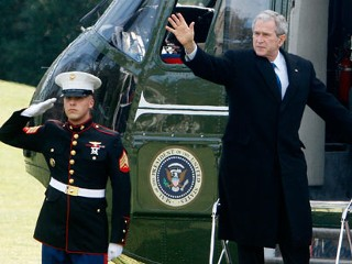 A U.S. Marine salutes as President George W. Bush waves from the steps of Marine One helicopter as he departs the South Lawn of the White House in Washington, Tuesday, Dec. 23, 2008, to spend the Christmas holiday at the Camp David presidential retreat. Before leaving for the holidays, President Bush commuted one prison sentence and granted 19 pardons, including one to a man who helped the Jewish resistance in the 1940s