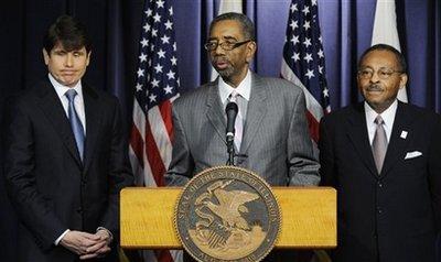 U. S Rep. Bobby Rush speaks after Illinois Gov. Rod Blagojevich announces his choice of former Ill. Attorney General Roland Burris, right, to fill President-elect Barack Obama's U.S. Senate seat Tuesday, Dec. 30, 2008 in Chicago.