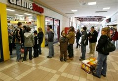 A line of shoppers extends out of the store into the mall hallway at the Game Stop store in Berlin, Vt., Friday, Dec. 26, 2008. Shoppers hit the stores early Friday to return unwanted gifts and take advantage of drastic price cuts offered by retailers desperate to get rid of old merchandise and boost their less-than-cheery holiday sales.