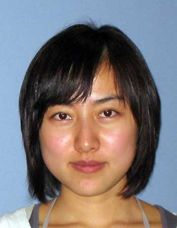 This undated photo provided by Virginia Tech shows the school ID photo of Xin Yang, 22, who was killed Wednesday night after arriving at the campus from Beijing on Jan. 8 to begin studying accounting. Her accused attacker, 25-year-old Haiyang Zhu of Ningbo, China, knew the victim but no motive for the slaying has been determined.