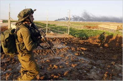 Smoke rose from central Gaza as Israeli soldiers crossed the border on Sunday.