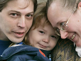 Heath Campbell, left, with his wife Deborah and son Adolf Hitler, 3, pose in Easton, Pa.