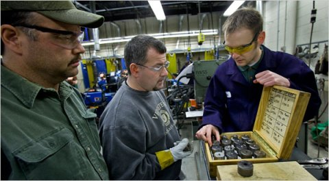 Adam Laabs, right, a welding instructor in Wisconsin, with Lance Buss, left, and Dan Geneen, who was laid off at a paper mill.