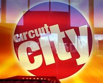 In this Nov. 10, 2008 file photo, a brightly lit sign is seen at the entryway of Circuit City in S. Portland, Maine. Bankrupt Circuit City Stores Inc., the nation's second-biggest consumer electronics retailer, on Friday, Jan. 16, 2009 said it failed to find a buyer and will liquidate its 567 U.S. stores. The closures could send another 30,000 people into the ranks of the unemployed.