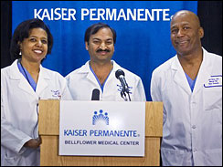 Doctors Karen Maples, left with Harold Henry, right and Mandhir Gupta center take questions at a news conference at the Kaiser Permanente Bellflower Medical Center in Bellflower, Calif. on Jan. 26, 2009.