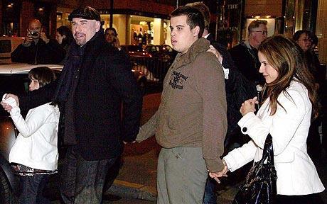 John Travolta with wife Kelly Preston enjoy a night out in Paris with their children Jett and Ella Bleu