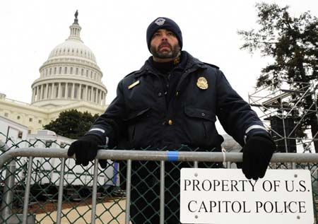 A police officer stands guard in front of the Capitol building in Washington Jan. 18, 2009. U.S. authorities are tightening up security in the capital city ahead of the Jan. 20 inauguration of President-elect Barack Obama.