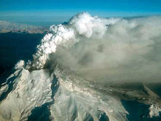 Redoubt Volcano, Alaska, during a continuous, low-level eruption of steam and ash, Dec. 18, 1989.