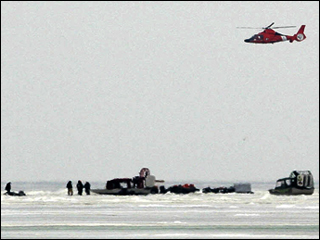 A helicopter flies over fishermen stranded on a slab of ice about 8 miles wide that broke free and floated away from the Ohio shoreline of Lake Erie, at Oak Harbor, Ohio, Saturday,  Feb. 7, 2009. The Coast Guard said about 150 people had been trapped on the ice and rescue operations were underway about 1,000 yards off shore.