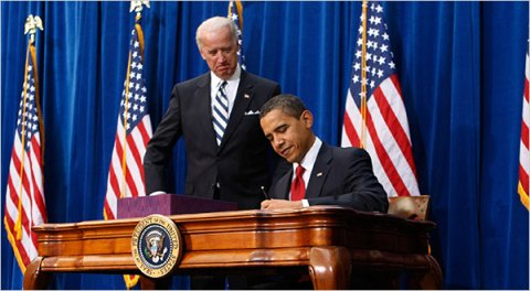 President Obama, with Vice President Joseph R. Biden Jr., signed the $787 billion stimulus bill at the Denver Museum of Nature and Science on Tuesday.