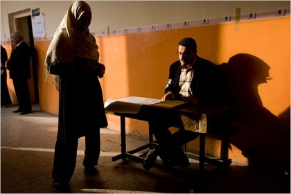 Poll workers waited for voters in the early morning at a school in the Adhamiyah neighborhood of Baghdad. Many parts of the country reported fairly light turnout in the morning, in the first voting for provincial candidates in four years.