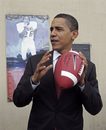 In this Feb. 21, 2008 file photo, Democratic presidential candidate Sen. Barack Obama, D-Ill. poses with a football during a tour of the University of Texas in Austin, Texas.  People would rather watch a football game with Barack Obama than with John McCain - but by barely the length of a football.  Obama was the pick over McCain by a narrow 50 percent to 47 percent, according to an Associated Press-Yahoo News poll  (AP Photo/Rick Bowmer, File