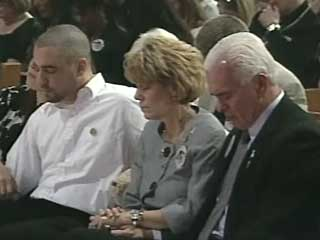 Slain girl Caylee Anthony's uncle Lee Anthony (left) and grandparents Cindy and George Anthony at her memorial service.