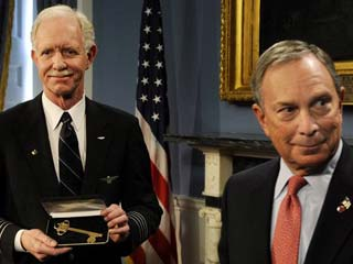 US Airways Capt. Chesley B. Sullenberger holds the key to the city he received from New York City Mayor Michael Bloomberg