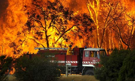 A fire truck in front a wall of flame at the Bunyip sate forest Tonimbuk township in Victoria, Australia