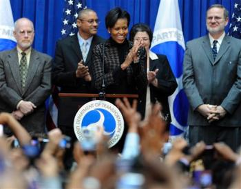 First lady Michelle Obama responds to the crowd as she arrives for a visit to the Transportation Department in Washington, Friday, Feb. 20, 2009. (AP Photo/Susan Walsh)