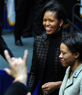 First lady Michelle Obama greets the audience as she visits the Transportation Department in Washington, Friday, Feb. 20, 2009. (AP Photo/Susan Walsh)