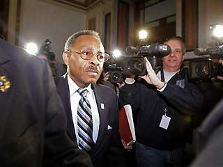 Sen. Roland Burris enters the Illinois state Capitol to testify before the House Impeachment Committee on now-former Gov. Rod Blagojevich.