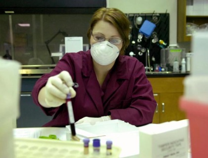 DNA analyst Julia Naylor works with blood samples in the State Police Crime Lab Monday July 16, 2007. The crime lab analyzes blood  for DNA evidence that is used in cases of sexual assault.
